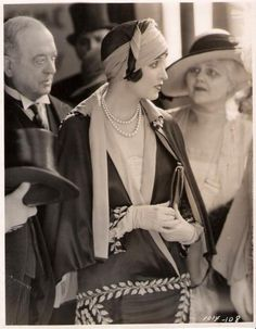 1926  Interesting juxtaposition of fashion eras. The look on the older woman says it all.