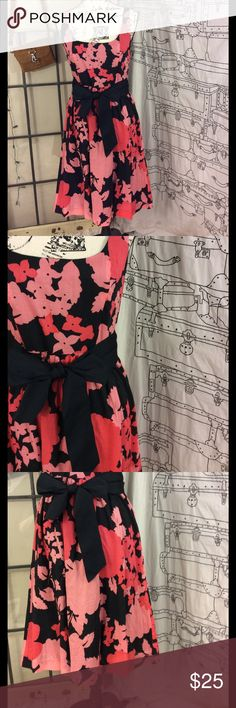 Kenzie  pretty  lined floral dress w/ ribbon tie Absolutely gorgeous Kenzie  pretty fully lined with ruffle  Ribbon tie at waist Muted pink and black floral design Side zip Flyers out it waste Length from top to bottom is 40 inches Armpit to armpit is 18 inches Waste is 15 inches Very gently used condition 100% cotton Lining is 100% cotton Kinsey pretty Dresses Mini