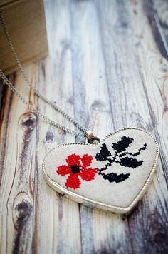 A beautiful embroidered flower in the same style that old Romanian grandmothers used to make with their granddaughters. It's a wonderful piece--simple and ethnic. Granddaughters, Grandmothers, Stainless Steel Chain, Embroidered Flowers, Heart Shapes, Ethnic, Crochet Earrings, Necklaces, Embroidery