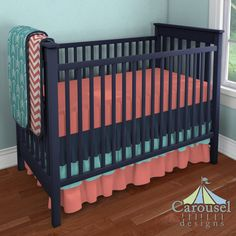 Crib bedding in Coral Zig Zag, Turquoise Arrow, Solid Navy, Solid Teal, Solid Coral. Created using the Nursery Designer® by Carousel Designs where you mix and match from hundreds of fabrics to create your own unique baby bedding. #carouseldesigns