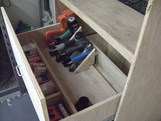 Adjustable portable tool rack with chargers and accessories.