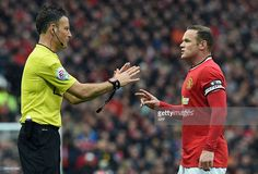 Manchester United's English striker Wayne Rooney (R) talks with referee Mark Clattenburg (L) during the English Premier League football match between Manchester United and Manchester City at Old Trafford