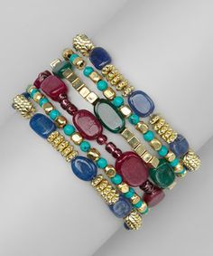 Dyed agate stones mingle with metallic gold beads in this set of six coordinated bracelets that stretch style around the wrist.