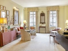Cooperative apartment on the upper east side of NY -- the expansive 30-ft drawing room, has a wood burning fireplace, herringbone floor and ceiling height of over 10 ft.