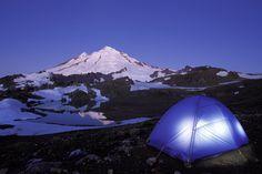Tent glowing below Mt Baker on a clear evening, North Cascades, Cascade Mountains, Washington - Brad Mitchell