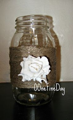 Mason jar, wrapp in burlap twine and add any decoration.  Idea for table decoration and/or party favors...