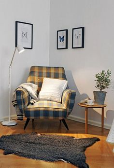 Small living room corner: comfy chair, pillow, throw, lamp, throw rug, small table. Not this style at all