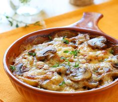 Scalloped Mushrooms: 1 pound fresh mushrooms 3 Tbs butter 1/3 cup whipping cream 1/2 tsp salt 1/4 tsp pepper 1/4 tsp cayenne 1 cup grated Monerey Jack cheese Saute muchrooms in butter add cream salt and pepper cayenne, place in dish top with cheese Bake 350 for 12 min until golden brown.