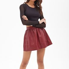 Forever21 faux leather skater skirt - burgundy (S) Cute and stylish faux leather skater skirt in a burgundy color. Elastic waist so fits a little tight but well for a size small/high waist Forever 21 Skirts Mini