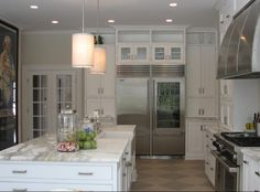 Caryn Bortniker: CJB Designs - Transitional kitchen with timeless details. Honed calcutta countertops, ...
