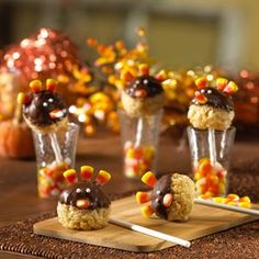 """Turkey Pop Treats®: Dip rice-krispie-treat balls into melted chocolate, add a few candy corn """"feathers,"""" and pop these tasty turkeys on top of lollipop sticks for a cute and creative Thanksgiving dessert. Thanksgiving Place Cards, Thanksgiving Treats, Fall Treats, Holiday Treats, Holiday Fun, Thanksgiving Turkey, Halloween Treats, Thanksgiving Decorations, Halloween Gif"""