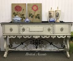 Artistically refurbished by British Accents. Chalk painted, glazed and waxed vintage buffet.