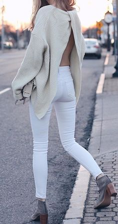 Love the sweater but poor hubby would have a heart attack if I wore it in public. Nude sweater, white jeans/ divine back details.