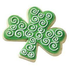 Sensational Color Flow icing swirls decorate this Comfort Grip™ Cutter cookie shamrock shape.
