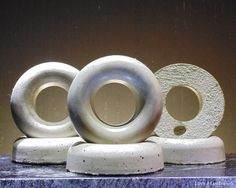 This is a rustic donut shaped cement paperweight. I have rubbed it with a dark wax to give it a more earthy look. There are 6 pictured. This listing is for ONE paperweight. Some have more air bubble Cement, Concrete, Donut Shape, Dark Wax, Paper Weights, Earthy, Donuts, Bubbles, Christmas Gifts