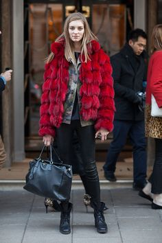 major déjà vu so apologies if it's a double up... #offduty in that epic red fur with the camo underneath. oh well pin it again! it rocks. London. #LFW
