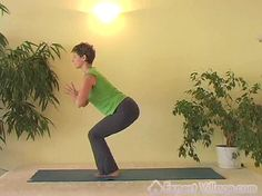 This is a single frame from a video at expertvillage.com called Chair Pose Yoga Video.    To see this video click here.    To see all of our videos on Advanced Yoga click here.