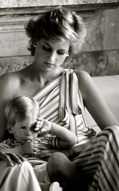 1986: Princess Diana in off the shoulder striped white with pastel colours dress, on holiday in Majorca, Spain.