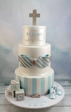 Three tiered blue and white cake for a little boys christening