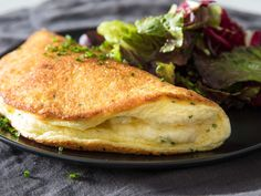 Much simpler than a classic soufflé, this omelette soufflé is cooked in a skillet on the stovetop, and it requires little more than eggs, cheese, and an extra couple minutes to beat the whites. Egg Recipes, Cheese Recipes, Cooking Recipes, Healthy Recipes, Omelettes, Egg Souffle, How To Make Omelette, Omelette Recipe, Cheese Omelette