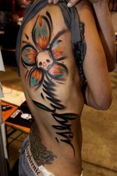 That absolute coolest tattoo I have seen in forever!! [Only the skull/flower part]