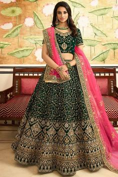 Dark Green velvet semi stitch lehenga with velvet choli. This lehenga choli is embellished with stone, sequins and dori work. perfect for Bridal Wear, Guest of Wedding Wear, Mehndi, Wedding Wear. Lehenga Top, Green Lehenga, Bridal Lehenga Choli, Silk Lehenga, Heavy Lehenga, Lehenga Wedding, Lehnga Dress, Lehenga Choli Designs, Designer Bridal Lehenga
