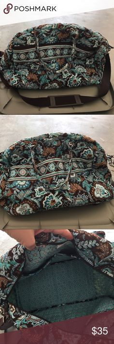 Vera Bradley travel bag Large Vera Bradley travel bag. Removable strap. Several compartments on inside and outside. Mainly blues and browns in color. Vera Bradley Bags Travel Bags