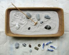 Make your garden charming by adding fish and rock charms for decoration. | 26 Zen Gardens To Help You Find Inner Peace At Work