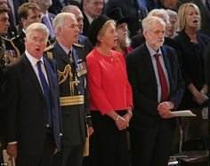 Refusal: As those around him including Defence Secretary Michael Fallon (far left) and AIr Chief Marshal Sir Andrew Pulford (second left) sang the national anthem today, the pro-republican leader of the Labour Party Jeremy Corbyn stood silent