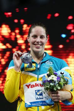 Silver medal winner Alicia Coutts of Australia celebrates on the podium after the Swimming Women's 200m Individual Medley Final on day ten of the 15th FINA World Championships at Palau Sant Jordi on July 29, 2013 in Barcelona, Spain.