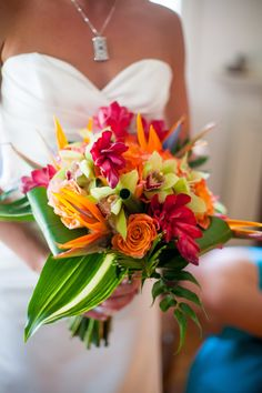Tropical Brides Bouquet, cymbidium orchids, orange roses, birds of paradise, red ginger