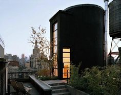 Above: A black water tower turned home by Messana O'Rorke in New York City.  10 Modern Houses Gone to the Dark Side: Gardenista