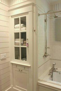 Linen Storage Behind Shower Wall