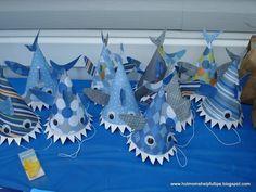 Paper shark party hats