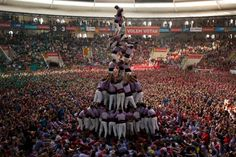 Members of the Castellers Collas Jove Xiquets de Tarragona fall as they tried to complete their human tower during the 25th Human Tower Competition in Tarragona, Spain.
