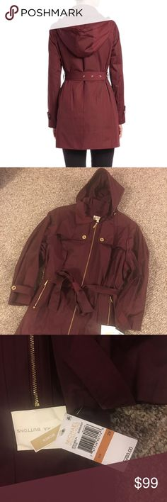 Michael Kors Plus Trench Jacket A gorgeous Burgundy Michael Kors Jacket with gold hardware. Buttons and zippers are all functional and have MK logo. Not to heavy and thick but just right! Fully lined and is a Cotton and polyester blend material. A must have beauty at a steal! Michael Kors Jackets & Coats Trench Coats