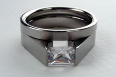 White Sapphire Engagement Ring Set - Titanium Tension-Set and Wedding Band - Satin and Polished Finish with Radiant Cut Sapphire. $449.00, via Etsy.