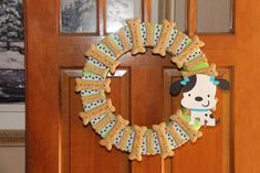 Puppy birthday party wreath! See more party planning ideas at CatchMyParty.com!