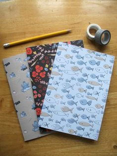 A set of three A5 notebooks or three A5 sketchbooks.  Each A5 notebook/sketchbook consists of 48 pages of lined/plain paper perfect for writing