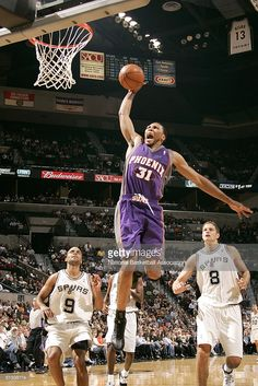 Shawn Marion # 31 of the Phoenix Suns shoots over the San Antonio Spurs during the