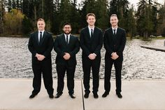 Formal groomsmen outfit idea - black suits and matching black neckties {Jason Comerford Photography}