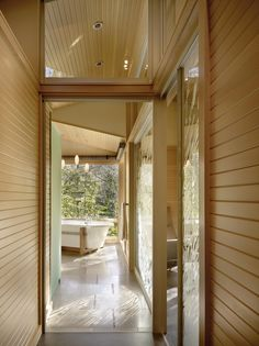 A house in the woods with sliding doors and room dividers by raumplus