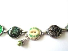 Green FOOTBALL antique button bracelet. 1800s buttons, silver links