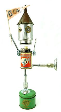 """Freaky Geeky"" Height: 21"" Principal Components: Plumbing sealant can, toy coffee pot, funnel, wrenches, hose fittings, candy molds, clock gears, t..."