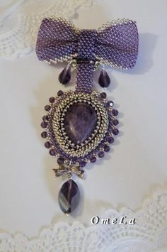 Lovely beaded brooch. Gorgeous shade of purple