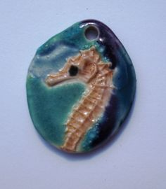 Teal Turquoise and Purple Porcelain Seahorse Focal by Clay Works of New Hampshire   Beads of Clay  Ceramic Bead Art. $17.00, via Etsy.