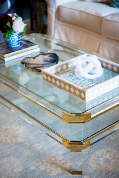 Love the brass touches on this acrylic table