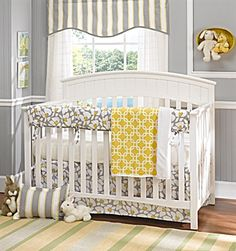 Gray and Yellow Poppy Baby Bedding Set. Gray and white with a pop of yellow, this set includes super soft minky baby blanket, a crib bed skirt, a crib rail cover with ties and a coordinating crib sheet.  www.lizandroo.com