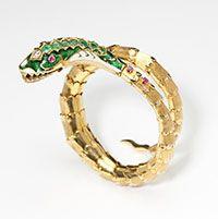 Lot# 1190 A gold and enamel snake bracelet.est: $1500/2000 *Price Realized: $3,000.00