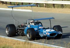 Matra's Jackie Stewart wins the 1969 South African Grand Prix. Dig the wings.